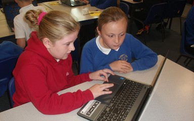 Class 7 enjoy using their new laptops